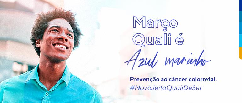 Foto de homem sorrindo, ao lado, a frase: Março Quali é Azul Marinho: Prevenção ao câncer colorretal #NovoJeitoQualiDeSer