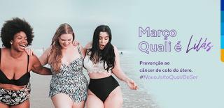 Três mulheres sorrindo na praia, ao lado a frase: Março Quali é Lilas. Prevenção ao câncer de colo do útero.