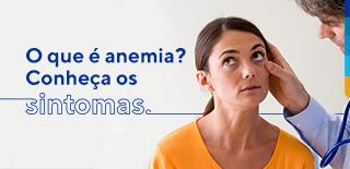 Texto: O que é anemia? Conheça os Sintomas. Ao lado, imagem de uma mulher olhando para o canto superior esquerdo, enquanto um médico examina seu olho direito.